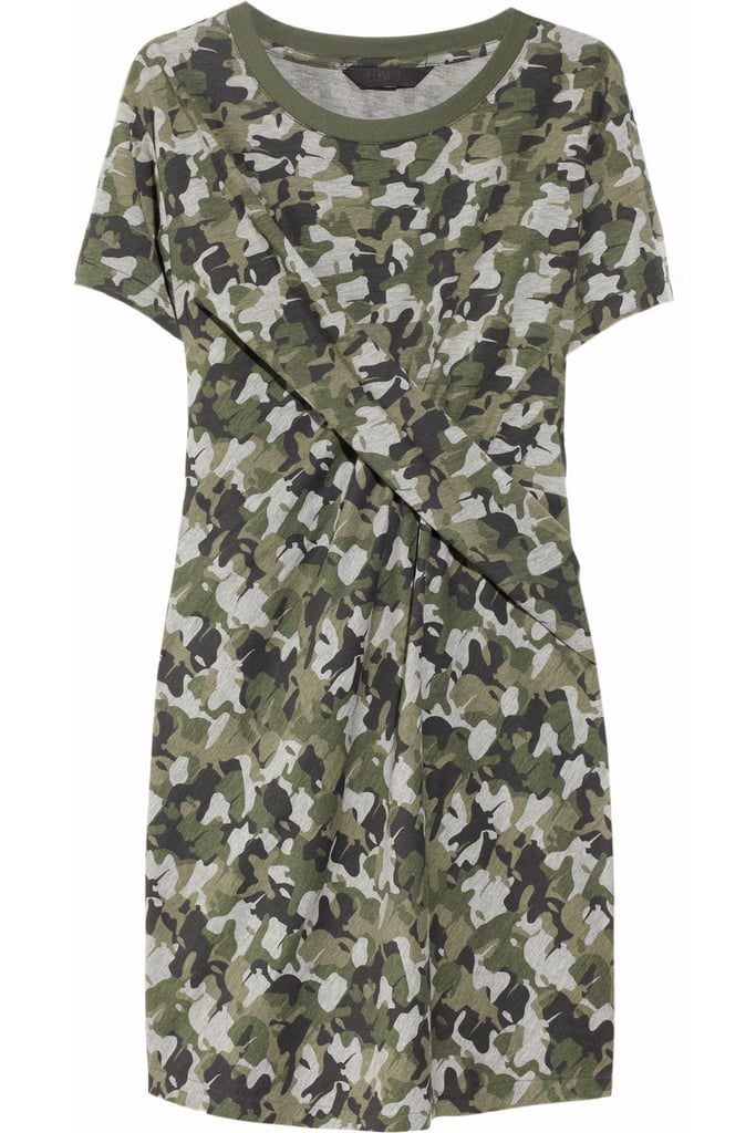 We'd wear this dress with suede ankle boots and a black — no, white — blazer with gold buttons. Karl Davin Camo-Print Twisted Jersey Dress ($185)