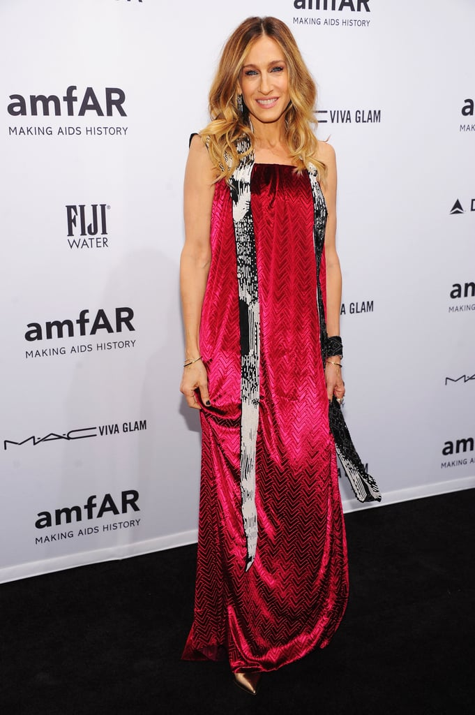 The trendsetter had tongues wagging in a velvety fuchsia Maison Martin Margiela gown, adorned with a whimsical black and white sash, at the 2013 amfAR Gala in NYC.