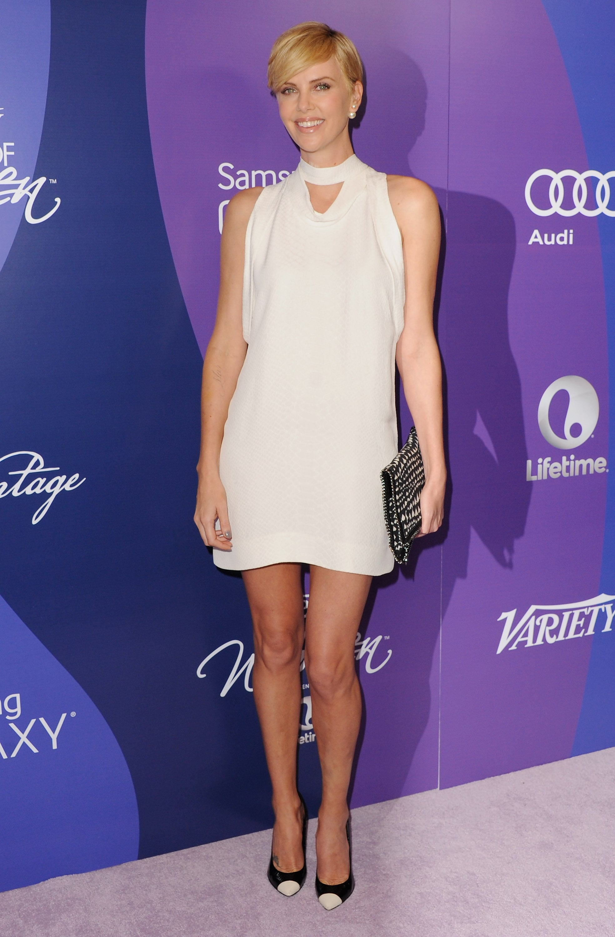 Charlize accented her white Stella McCartney dress with black accessories, making for a look that's both edgy and flirty.