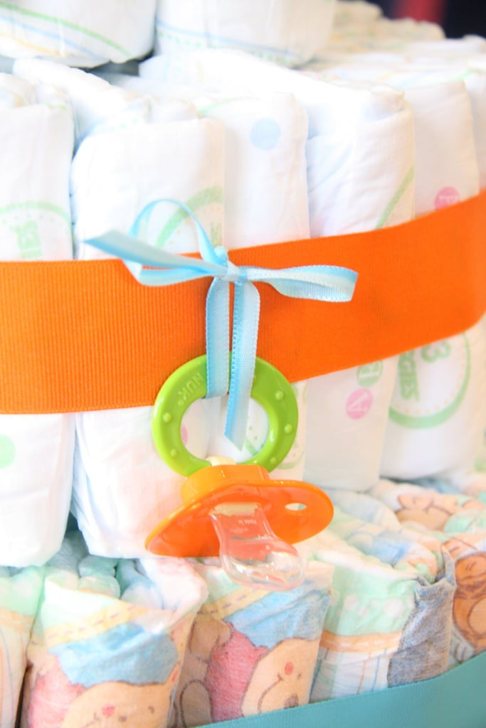 Add pacifiers, onesies, aspirators and the like for extra decoration.