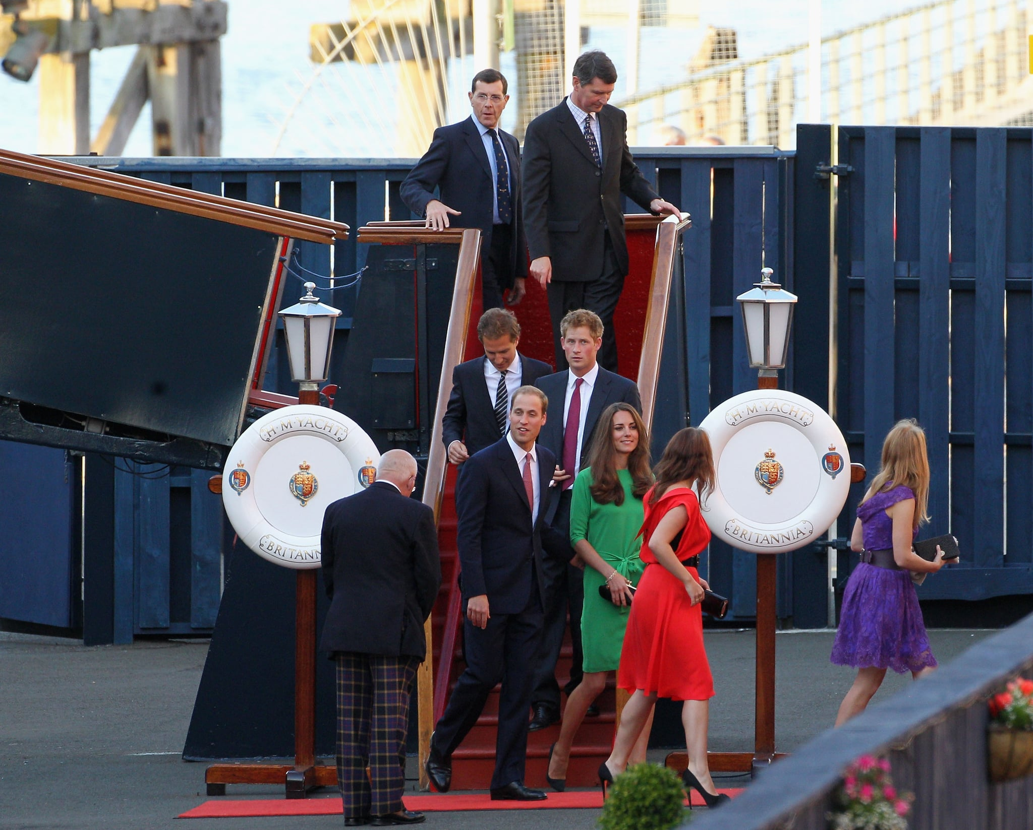 Dave Clark, Prince Harry, Prince William, Kate Middleton, Princess Eugenie, and Princess Beatrice leave the Royal Yacht Britannia.