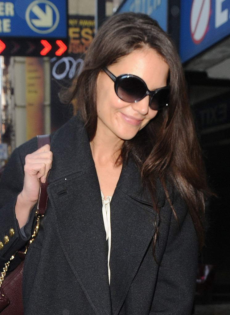 Katie Holmes let her hair down on her way to her last performance.
