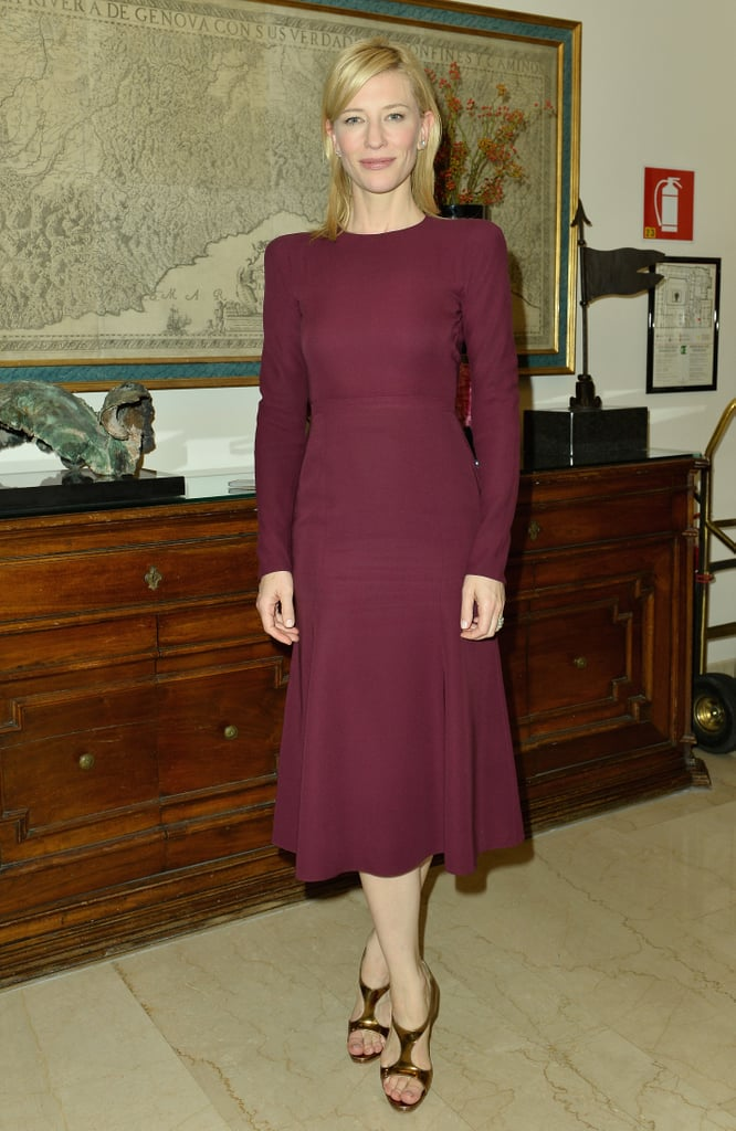 Cate Blanchett was demure in a purple long-sleeved Gucci dress from the Fall 2013 collection during a Milan Fashion Week photoshoot. But a pair of gold metallic t-strap Christian Louboutin Sylvette sandals lent just the right amount of pizzazz to her style.