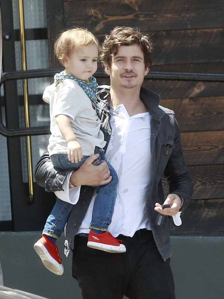 Orlando Bloom held son Flynn in one arm during a day out in LA in April.