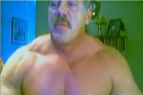 Muscle Man Admires Himself for the Camera