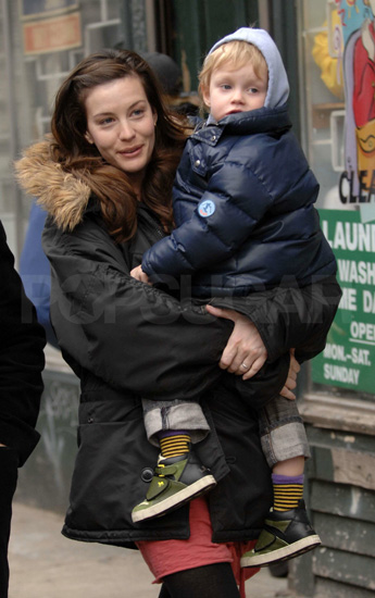 Liv Tyler and son Milo braved a little NYC rain.