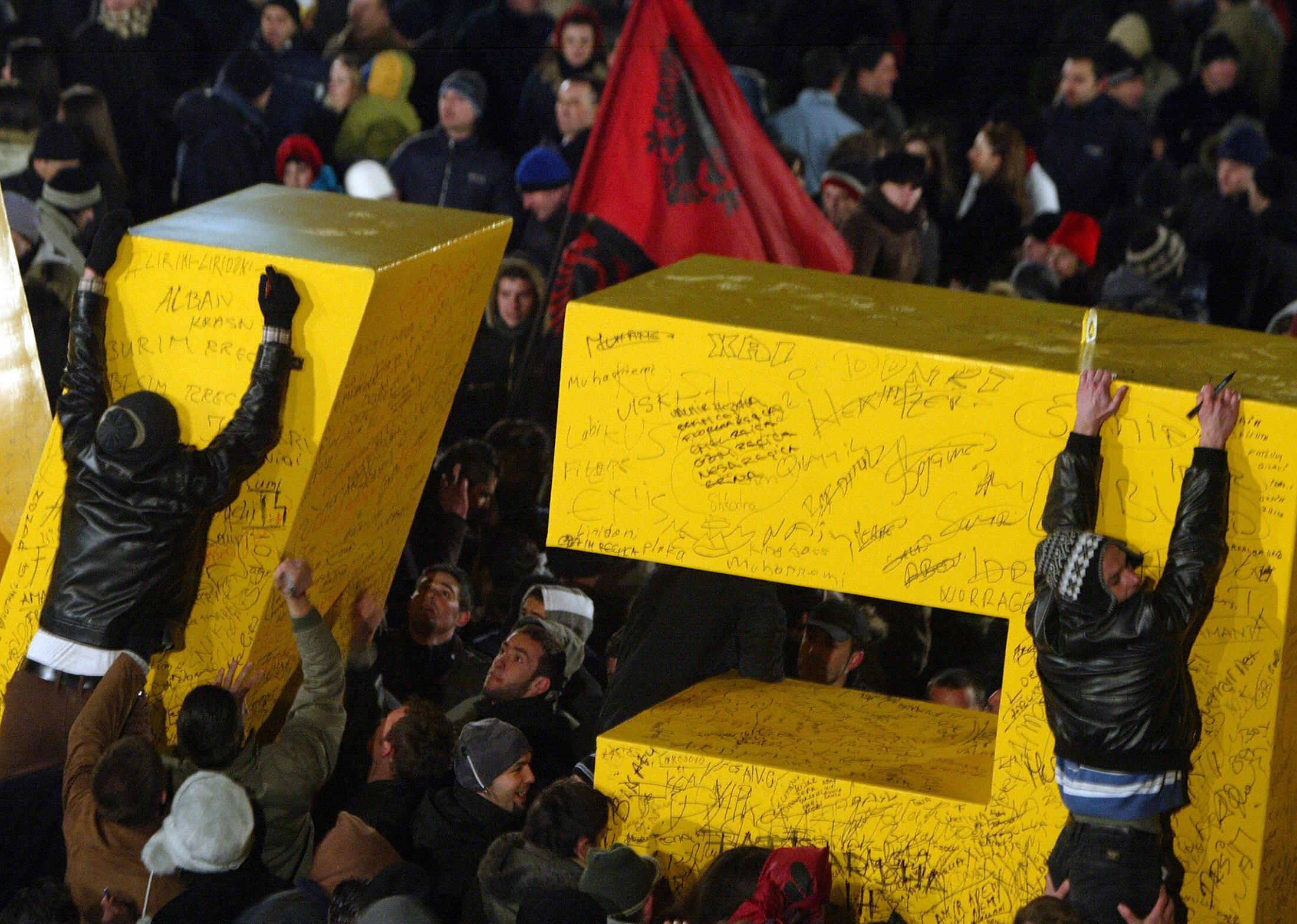 "Kosovars climb letters reading ""New Born"" in Pristina on February 17, 2008."