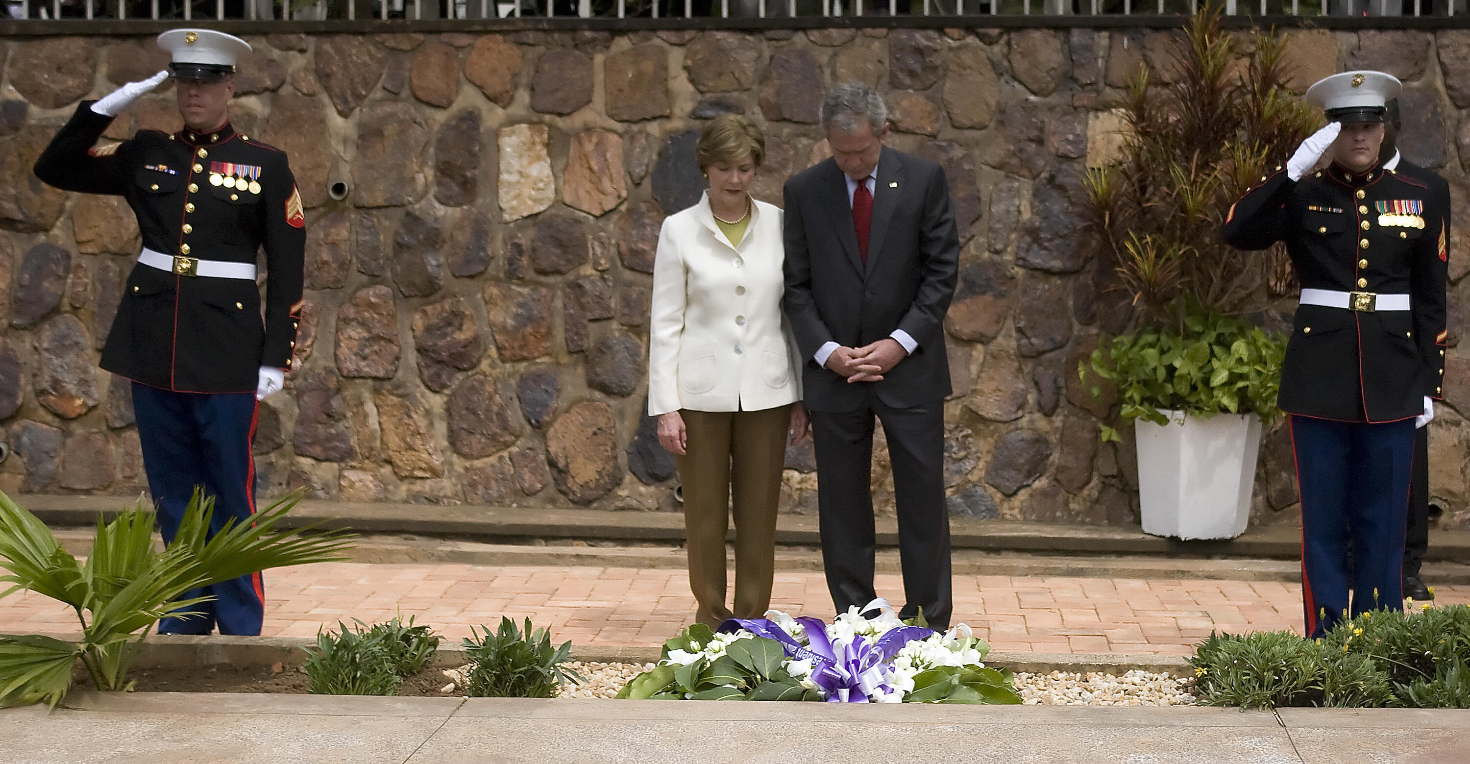 Mr. and Mrs. Bush lay a wreath at a Rwanda genocide memorial.