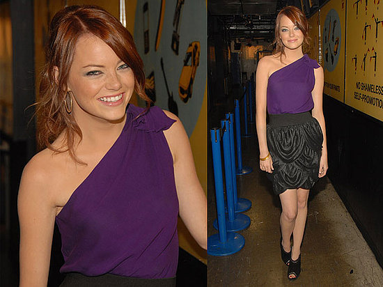Emma Stone in a Purple Abaete One-Shoulder Top, a Bubble-Hemmed Yigal Azrouel Skirt, and Jimmy Choo Peep Toe Booties