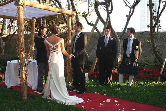 Bride, groom, groomsman and best man.