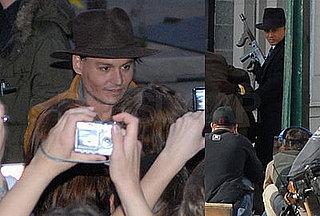 Johnny Depp Poses For a Few Hundred Cameras