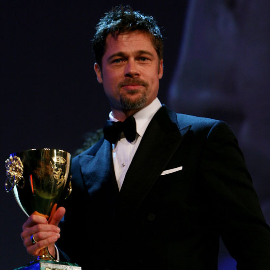 Photo of Brad Pitt with Best Actor Trophy at 2008 Venice Film Festival