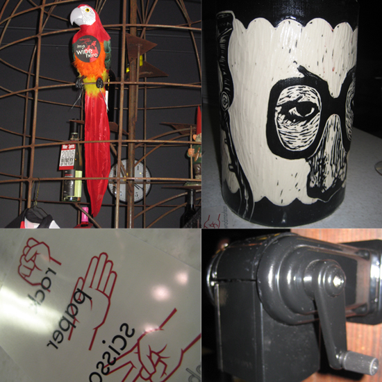 A fake parrot sits in an oversized birdcage. The spit bucket is a man's face. A manual pencil sharpener ties in with the lockers.  Scott, our pourer, gave us all rock, paper, scissors tattoos.