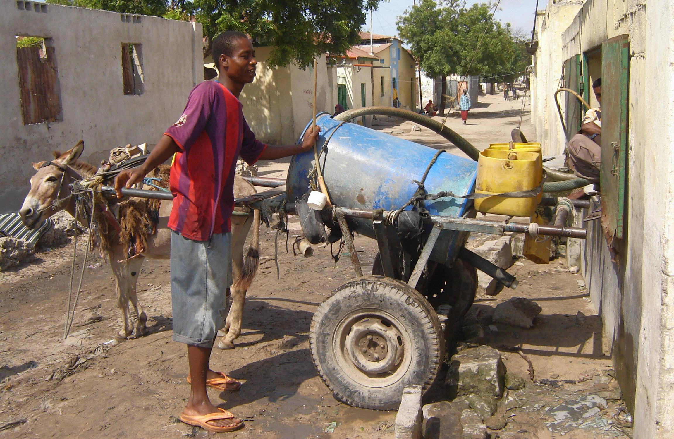 A boy sells water door-to-door in Somalia, tied for most corrupt. Pirates often seize aid shipments to the country.