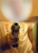 Dad Forces Six-Year-Old to Pose With Pistol For Pictures