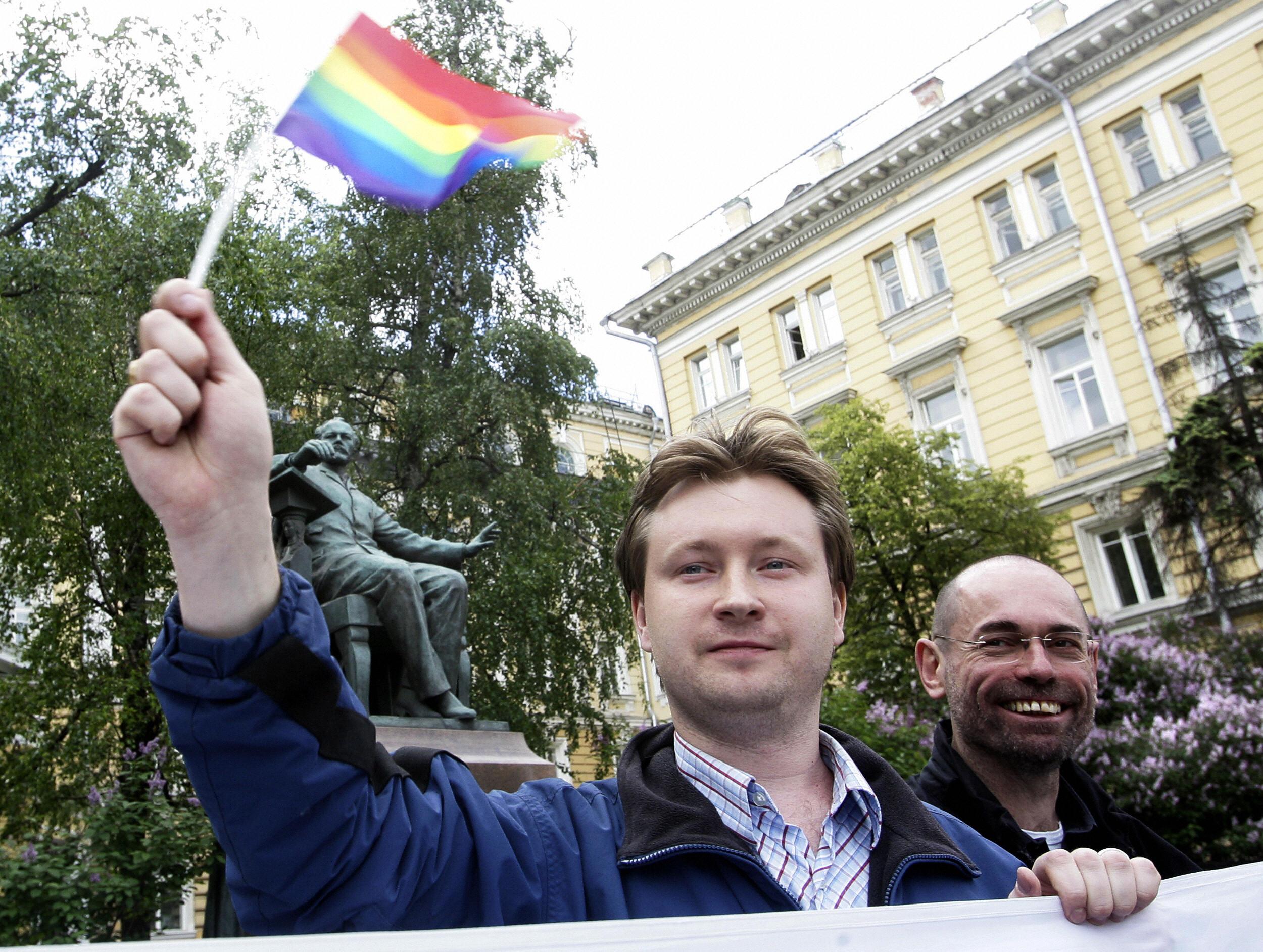 Russian gay community leader Nikolai Alexeyev waves a flag.
