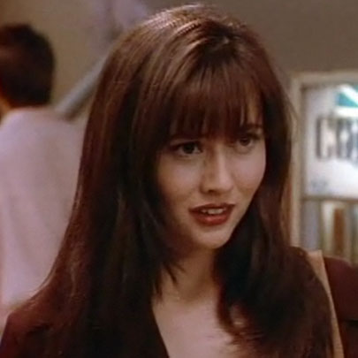 Brenda's brick-red lips preceded the huge brown-lipstick trend of the '90s.