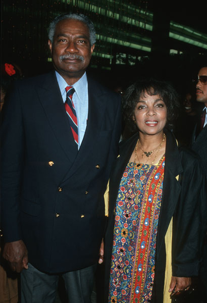 With her hubby in 1989.