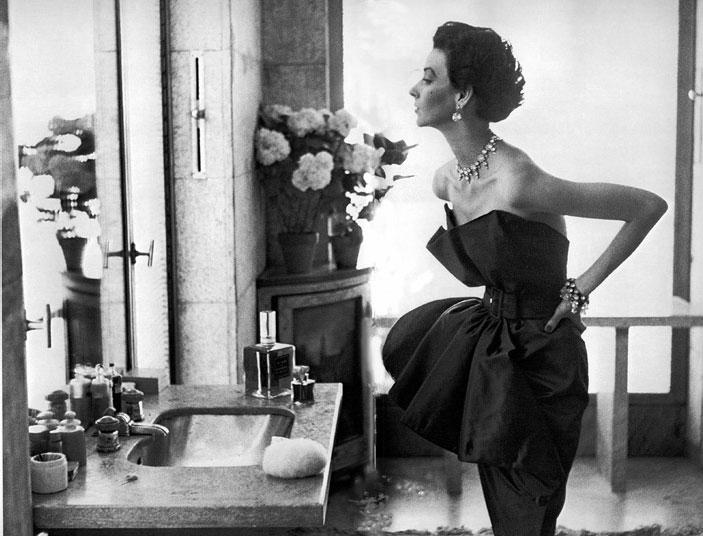 Dorian Leigh, dress by Piguet, photograph by Richard Avedon, Helena Rubenstein's apartment, Paris, 1949.