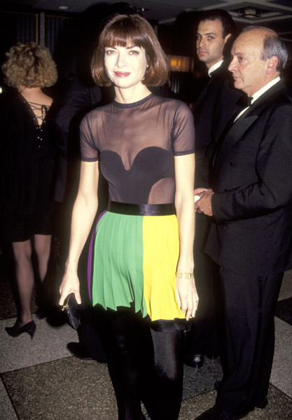 Dec. 1991: Sheer top, cleavage, and miniskirt? Not the Anna we know today.