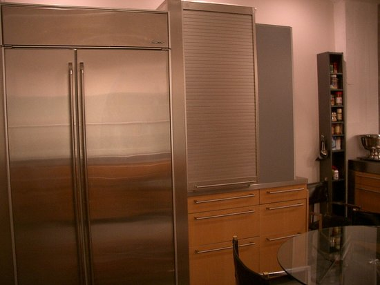 This is a picture of our Dacor fridge and appliance garage. It serves as a pantry too!