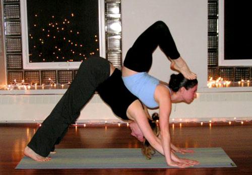Partner Yoga Pose: Down Dog Scorpion