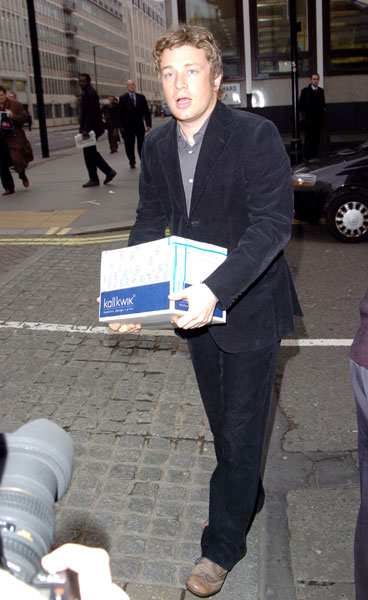 Jamie uses his celebrity power to effect social change. Here, the chef petitions healthier meals for schools at a March 2005 meeting at London's Conservative Campaign headquarters.