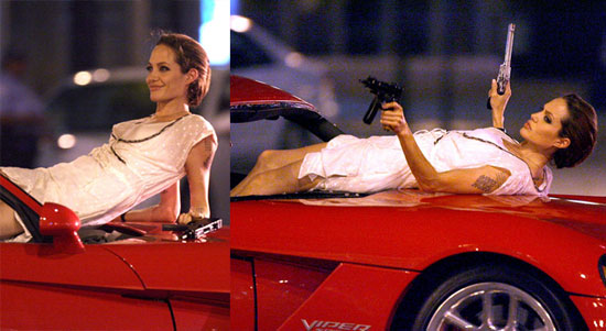 Angelina's Got Guns And She Knows How To Use Them