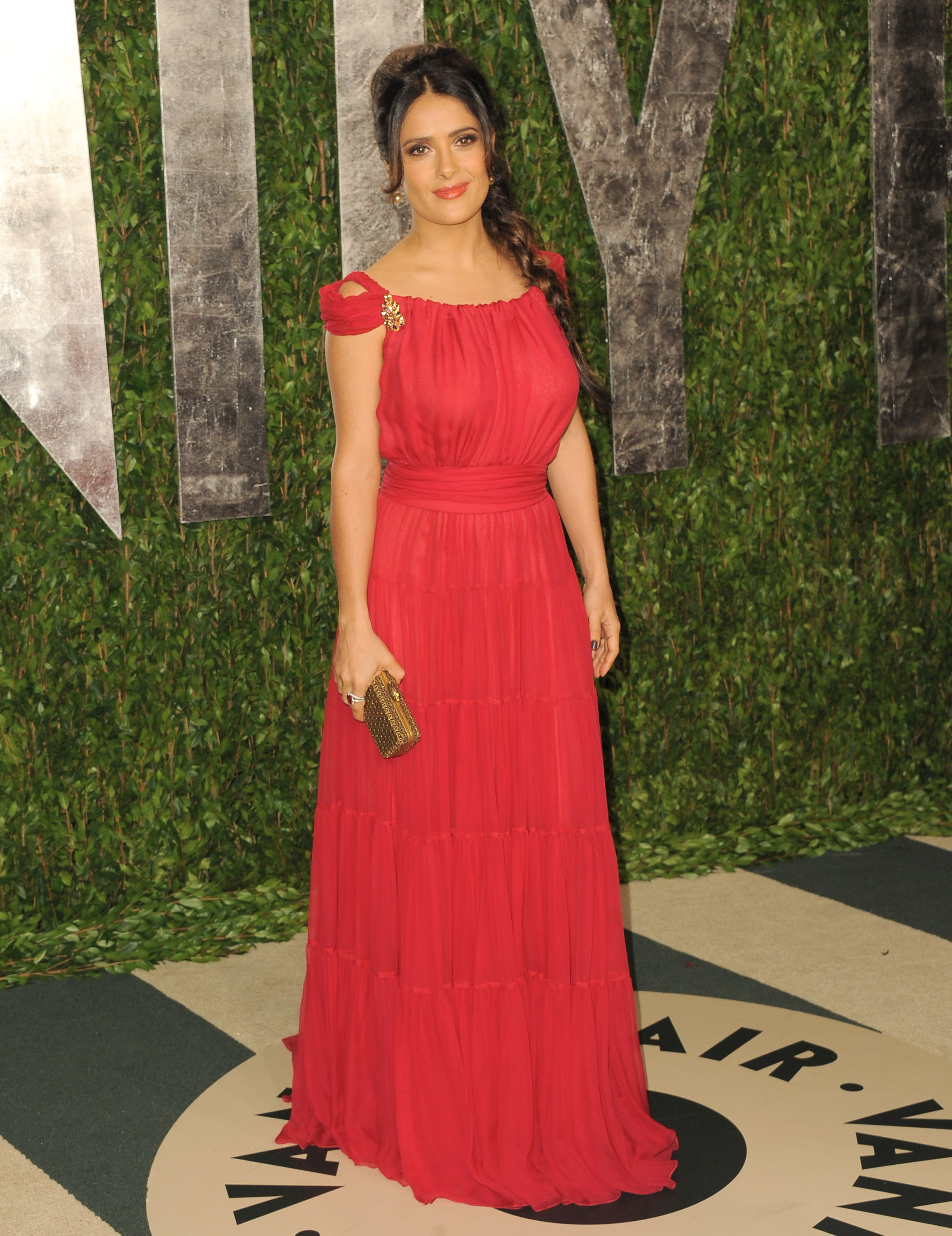 Salma Hayek looked stunning with her long Rapunzel-inspired braid and red Yves Saint Laurent silk chiffon gown.