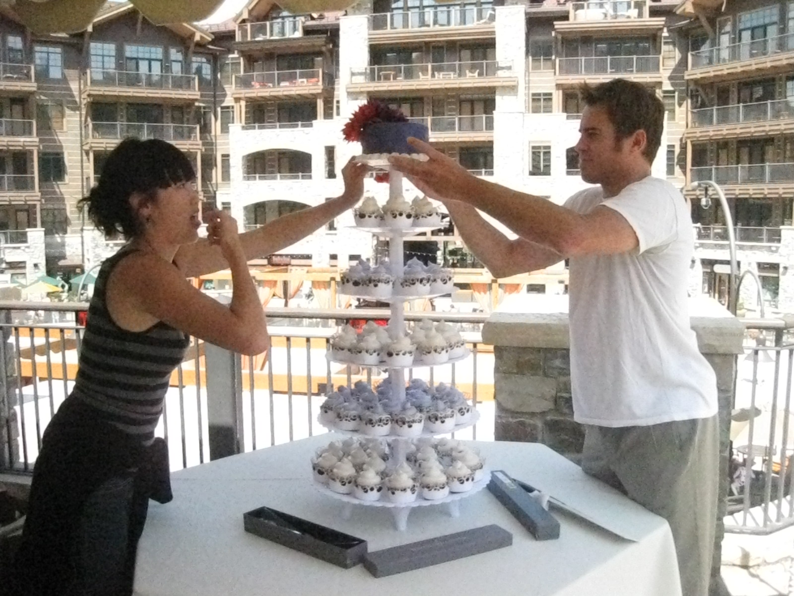Grace and her husband assembling the tower at the reception location.