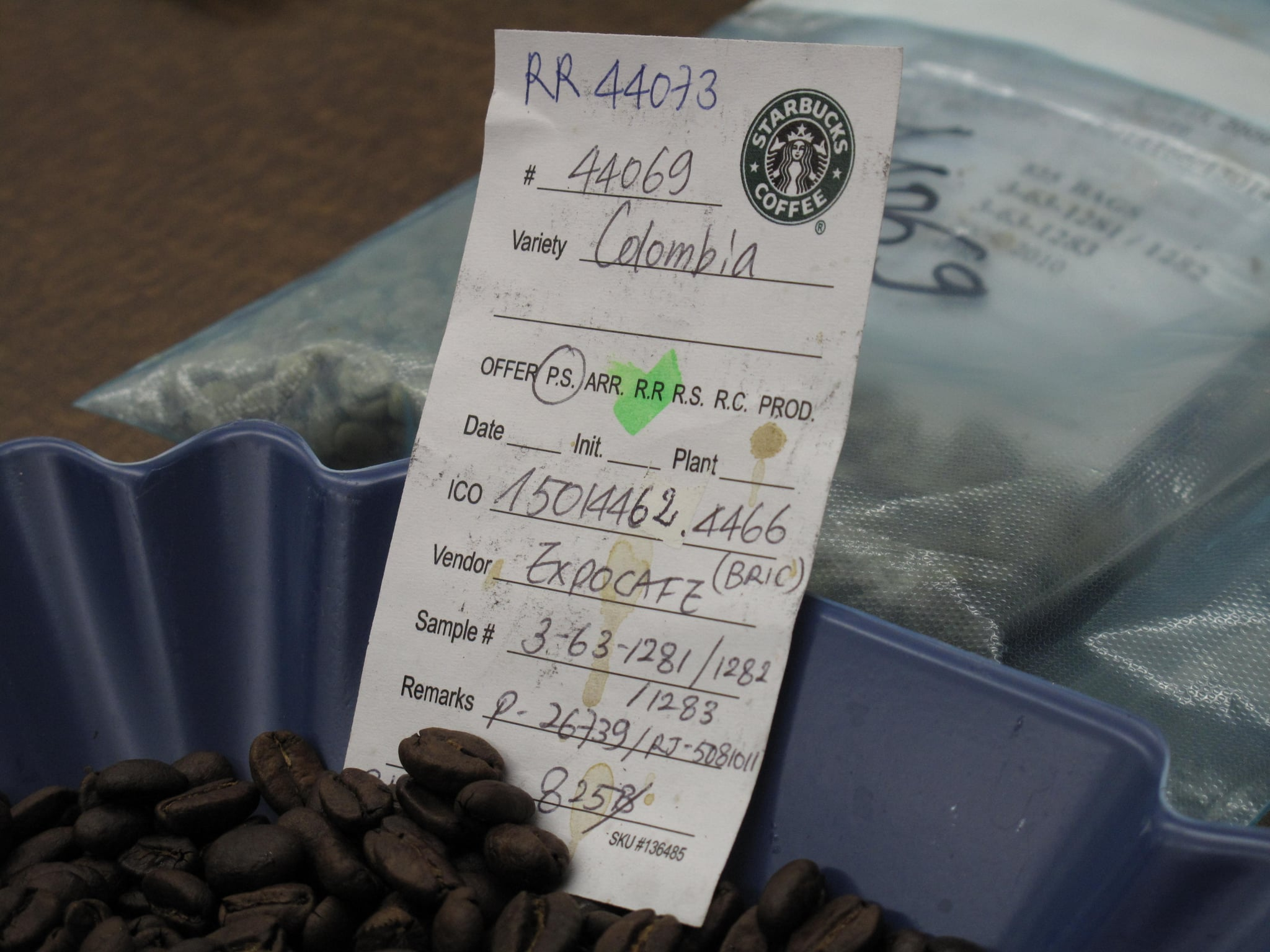 Fifteen people comprise the Starbucks coffee quality team; together, they taste more than 250,000 cups of coffee a year. Yes, 250,000. The label pictured here is typical at a cupping, and denotes crucial information about each batch, including its origin.
