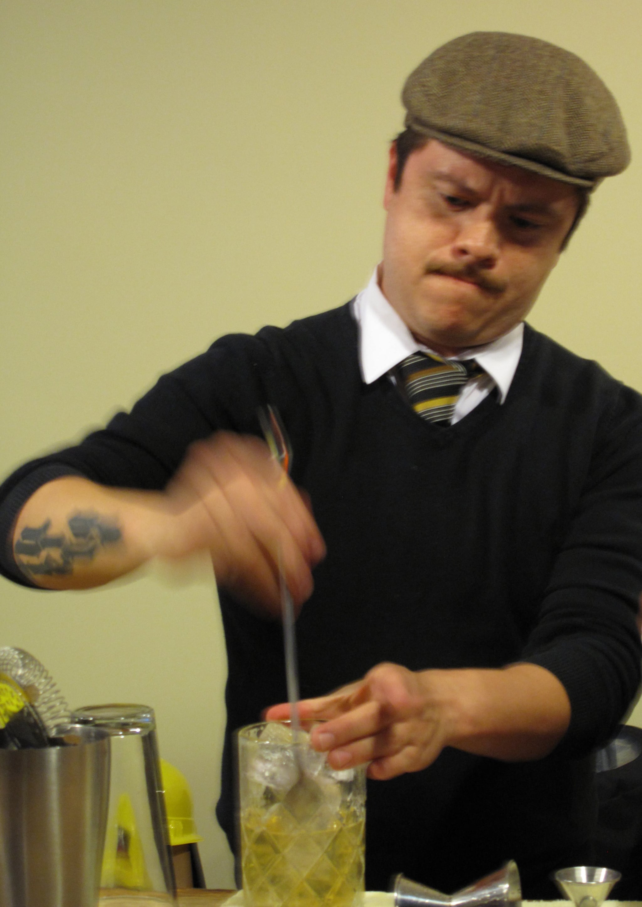 Plymouth and Beefeater brand ambassador Erick Castro whips up a Claridge cocktail with his bar spoon.