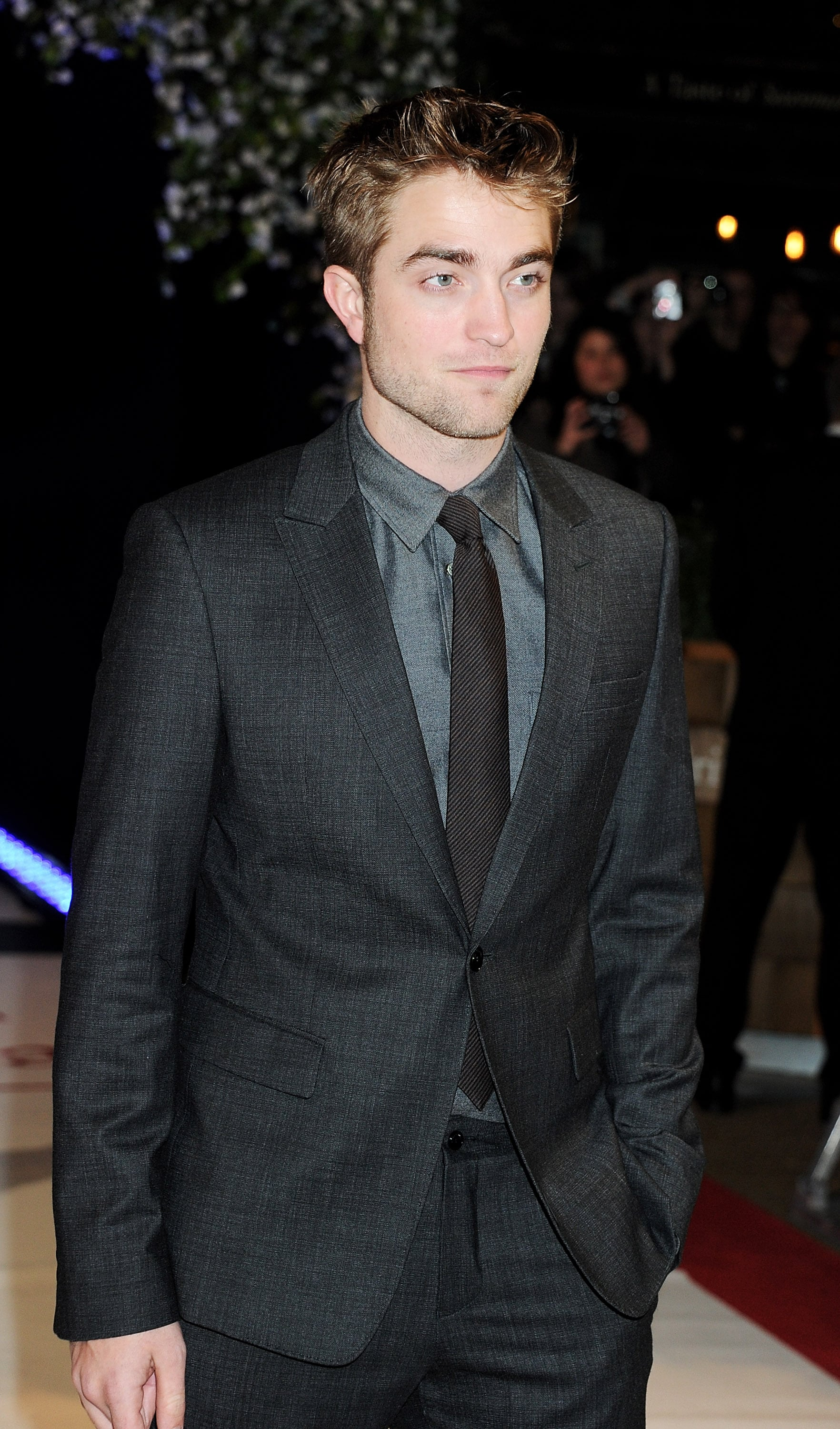 Robert Pattinson in a suit at the UK premiere of Breaking Dawn Part 1.