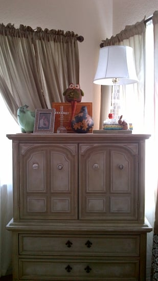 Dresser dressed up with knick knacks in a corner of our living room given the room a comfortable and homey feel. I replaced the knobs with once that I found from various antique stores.