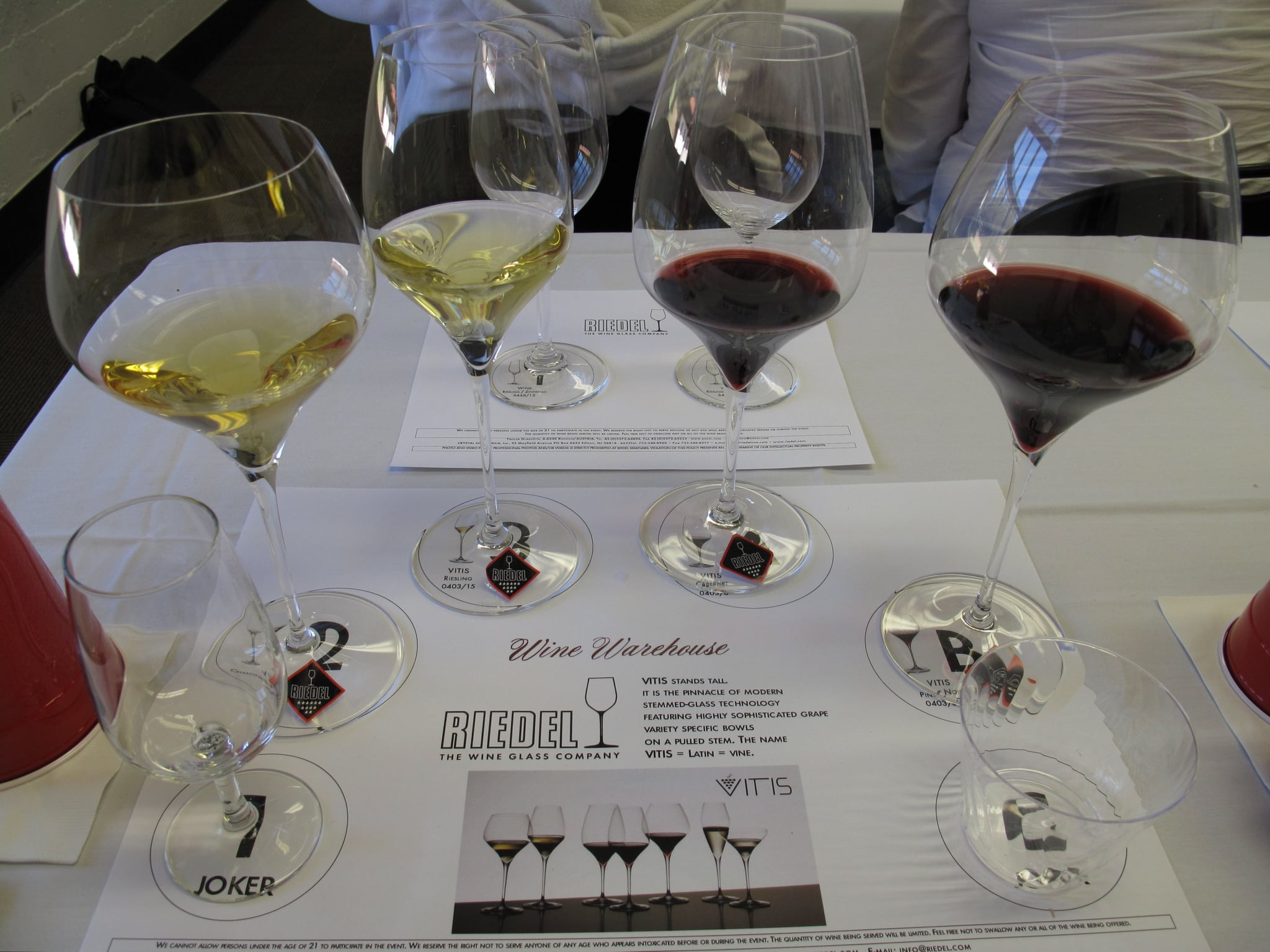 Filled glasses. From left to right, the Riedel Vitis Montrachet/Chardonnay glass, Riesling/Sauvignon Blanc glass, Cabernet glass, and Pinot Noir glass.