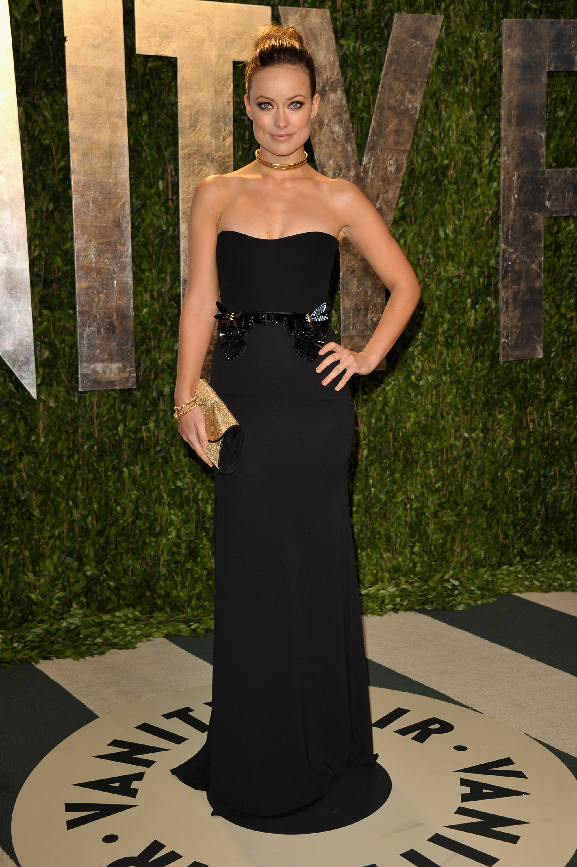 Olivia Wilde in a Gucci gown and gold jewels.