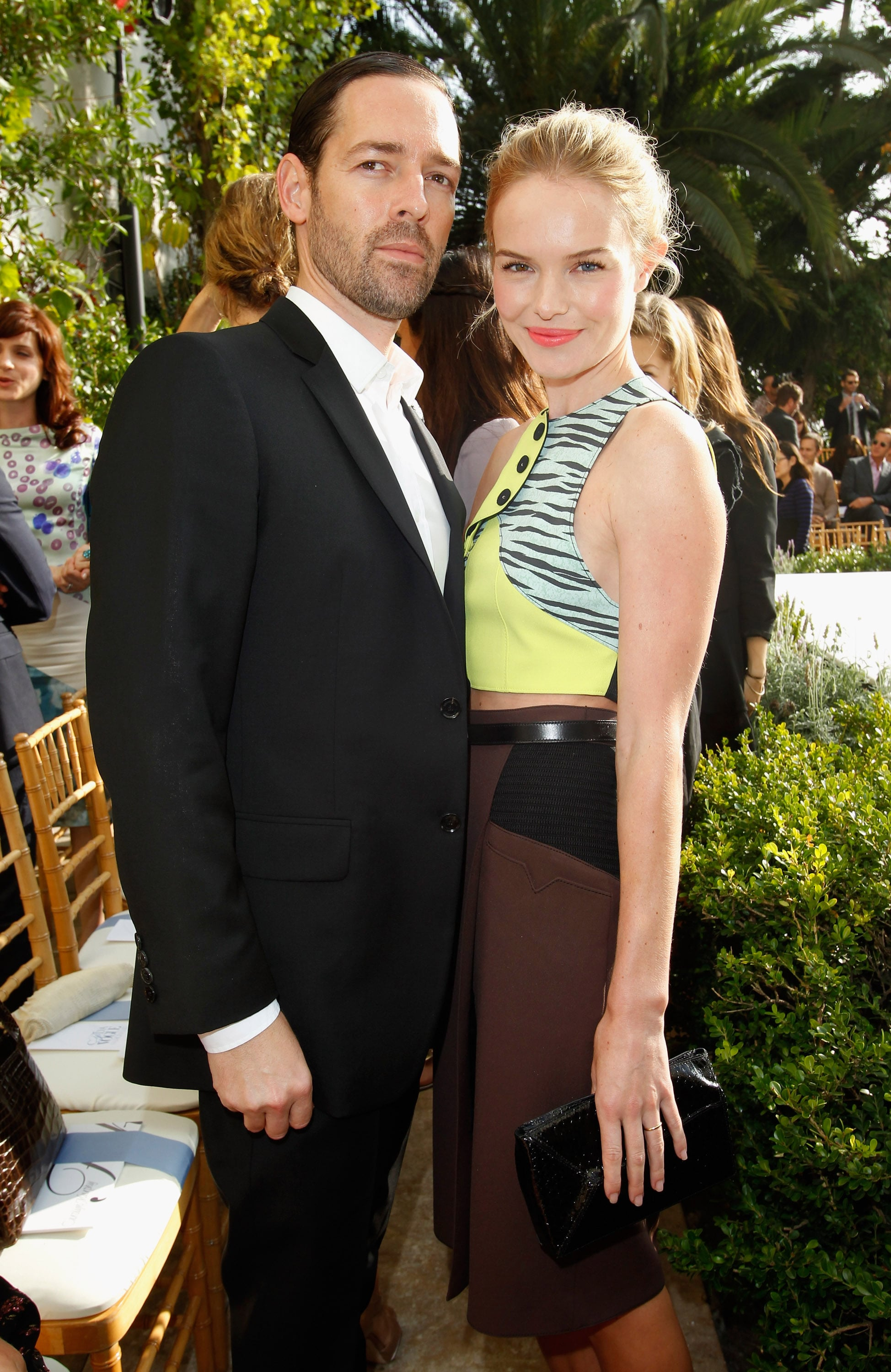 Kate Bosworth and Michael Polish wore matching rings on their ring fingers at a party in LA.