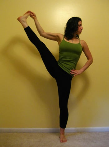 strike a yoga pose standing hand to big toe b  popsugar