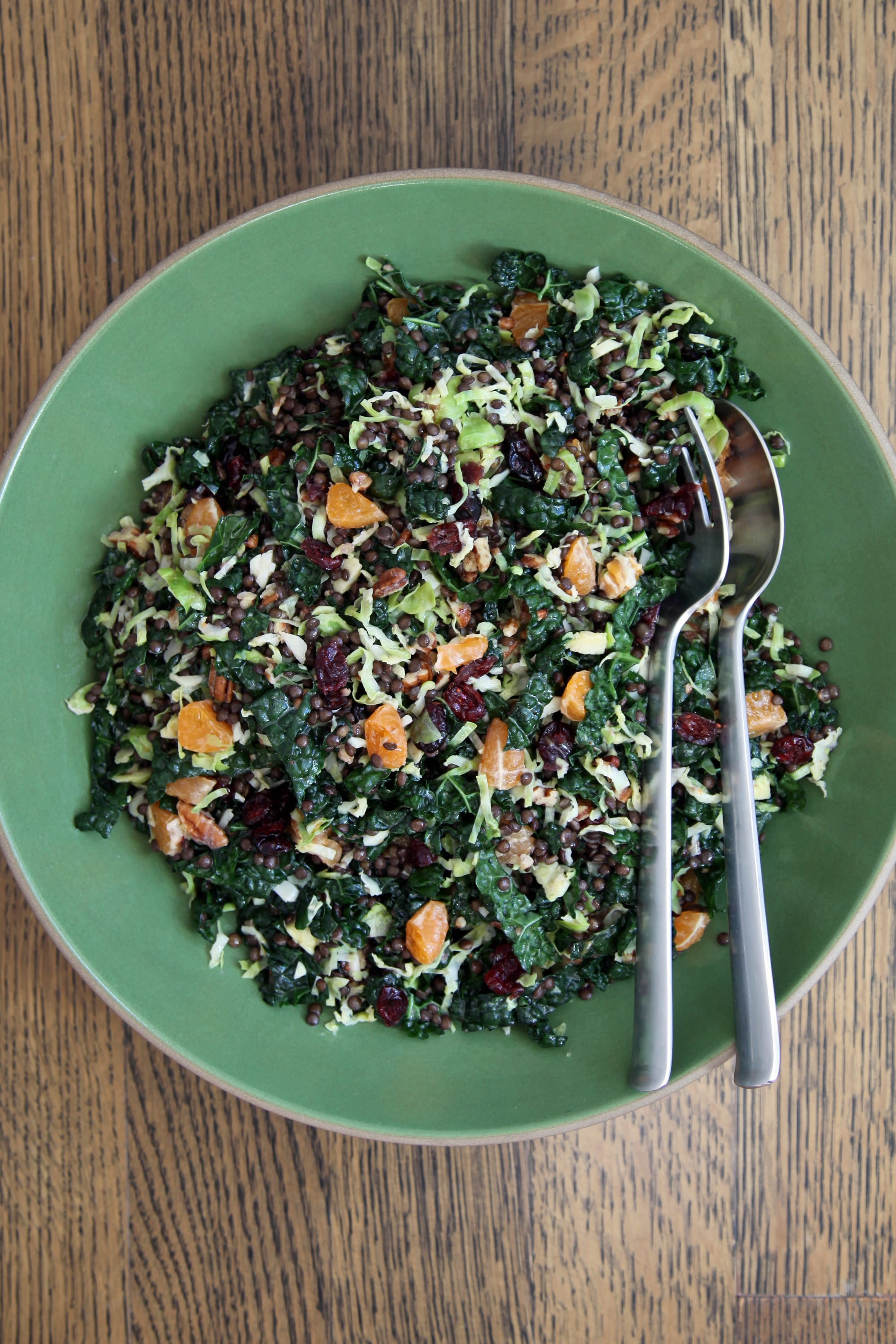 PopsugarLivingSaladsBrussels Sprout, Lentil, and Kale Salad With CranberriesA Gloriously Green Brussels Sprout, Kale, and Lentil SaladMarch 9, 2018 by Nicole Perry2.5K SharesChat with us on Facebook Messenger. Learn what's trending across POPSUGAR.Decadent comfort foods absolutely have a time and place, but one can't subsist on butter, cream, cheese, and potatoes alone. When you need a respite, be sure to consider this gloriously green salad. Kale, brussels sprouts, and glossy black beluga lentils provide its wholesome base, while dried cranberries, toasted pecans, and clusters of clementine wedges are a festive nod to the season. While it's best the day of, it can be made ahead with almost as good results. To keep it fresher in texture, add the clementine wedges just before eating, as they tend to wilt by the second day.Brussels Sprout, Beluga Lentil, and Cranberry Holiday SaladAdapted from Green Kitchen Travels by David Frenkiel and Luise VindahlNotesFrench green lentils or other lentils that hold their sha - 웹