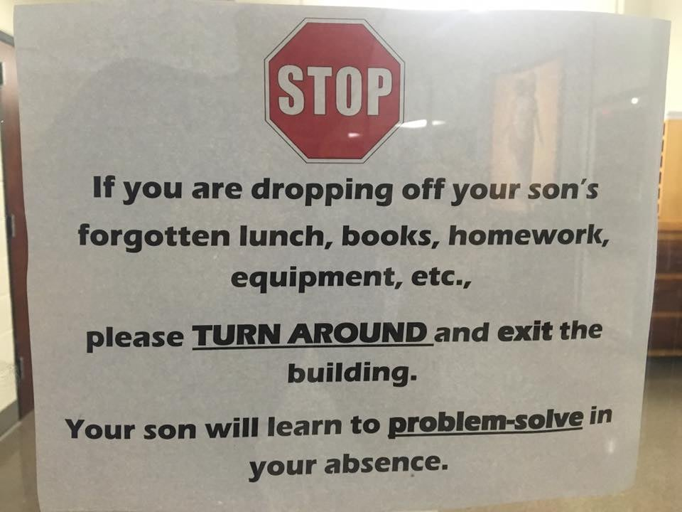 High School principal's sign instructs some 'enabling' parents to exit the building