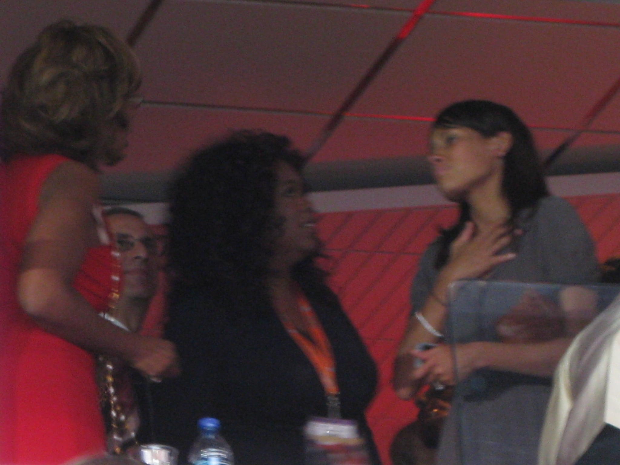 Oprah and Gayle in red.