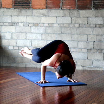 strike a yoga pose side crow  popsugar fitness