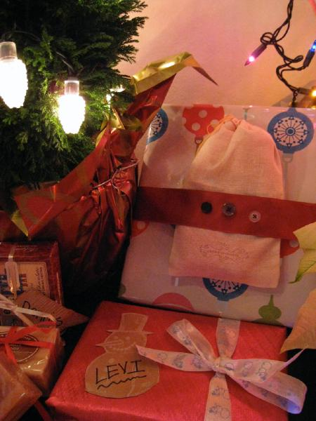 """Close up of handmade gifts; the """"button ribbon"""" was a cute idea I stole from Anthropologie & I made gift tags out of TJ's bags"""